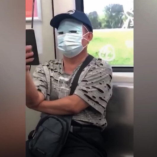 Çinli vatandaş koronavirüs korkusuyla yüzünün tamamını maskeyle örttü