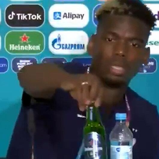 Fransız yıldız Paul Pogba basın toplantısı sırasında masadaki bira şişesini kaldırdı