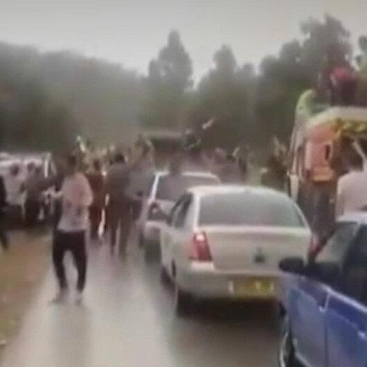 Cezayirde orman yangınlarını söndürme çalışmaları esnasında şiddetli yağmur yağdı