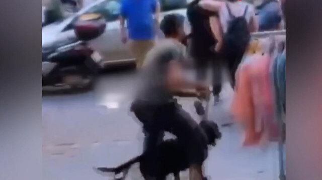 İş yerini dağıtıp köpeğini vatandaşların üzerine saldı