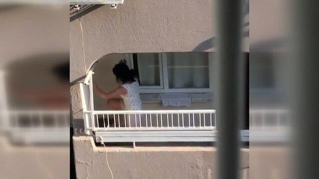 Adana'da köpeğe eziyet eden kadın kamerada