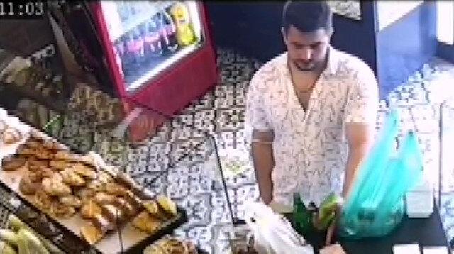 Tezgaha koyduğu parayı geri alıp para üstü ve ürünlerle fırından ayrıldı