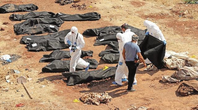 Afrin'de  kazdıkça ceset çıkıyor: İnfaz edip toplu mezara gömmüşler