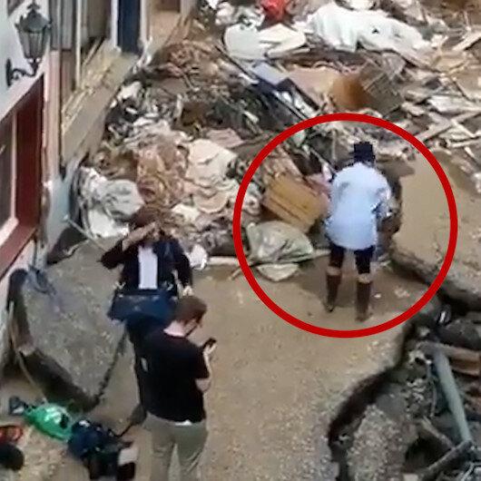 Almanyadaki sel felaketinde kendini çamura bulayan muhabir kovuldu