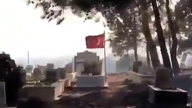 Alevler içinde kalan mezarlıkta şehit kabri ve Türk bayrağı yanmadı