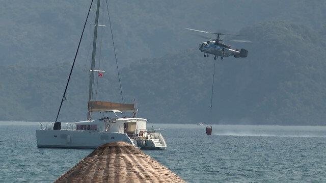Helikopterlerin durmaksızın denizden su alarak yangına müdahale anları kaydedildi