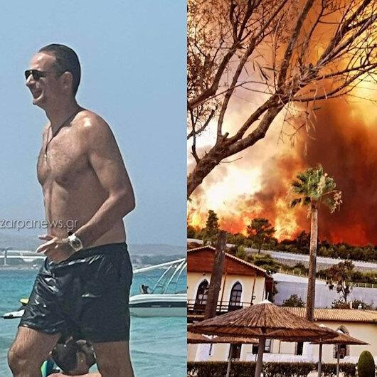 Yunanistan'da köylerin boşaltıldığı yangınla mücadele sürerken plajda poz veren Başbakan Kiryakos Miçotakis tepkilerin hedefinde
