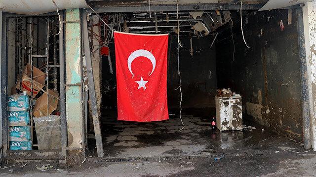 Bozkurt'ta selin vurduğu dükkanlara Türk bayrakları asılıyor