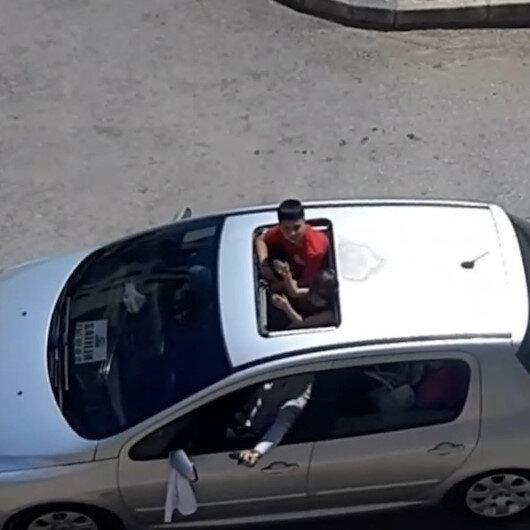 İzmirde düğün konvoyunda maganda dehşeti: Üstü açık arabadan silahla havaya ateş açtı