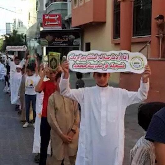 Gazzede 700 Filistinli çocuk Kuran-ı Kerim öğrenmenin önemine dikkat çekmek için yürüdü