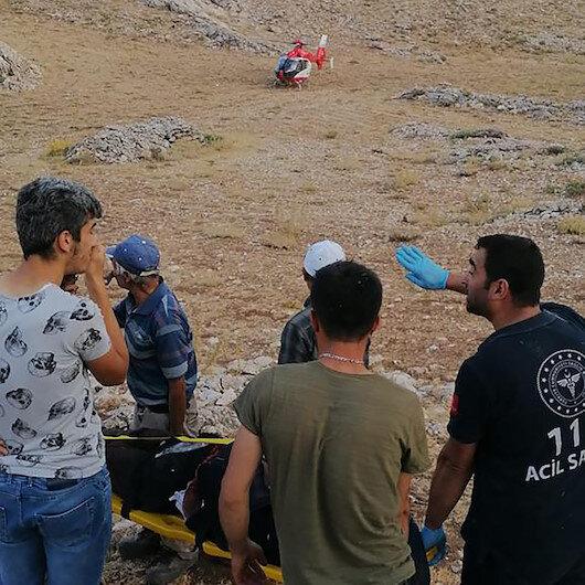 Karamanda kayalıklara düşen çobanın yardımına ambulans helikopter yetişti