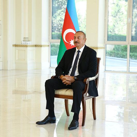 Aliyev işgalden kurtarılan topraklara ziyaretini anlatırken gözyaşlarını tutamadı
