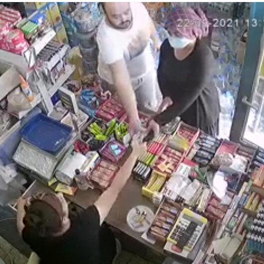Adanada market sahibinin tırnakçılık şüphelisini yakaladığı an kamerada