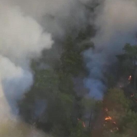 Antalyanın Kemer ilçesinde çıkan orman yangınına müdahale ediliyor