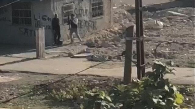 Adana'da sokak ortasında silahlı kavga: Duvarları siper alıp çatıştılar