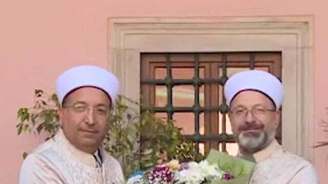 İstanbul Müftülüğüne atanan Prof. Dr. Safi Arpaguş Ali Erbaş'ın elinden cübbeyi giyerek göreve başladı