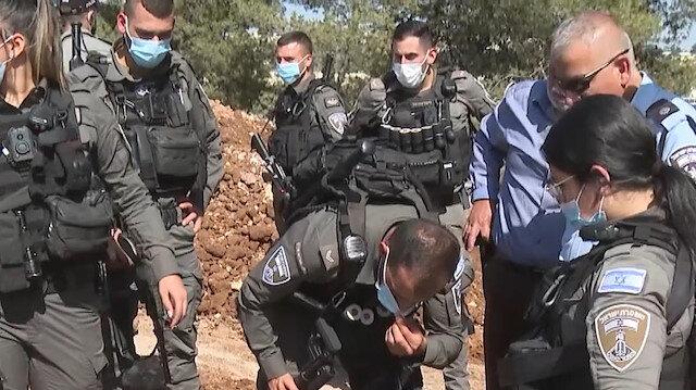 Kudüslü anne İsrail'in Müslüman mezarlığındaki yıkımına oğlunun kabri başında tepki gösterdi: Filistinlilerin ölülerine bile rahat vermiyorlar