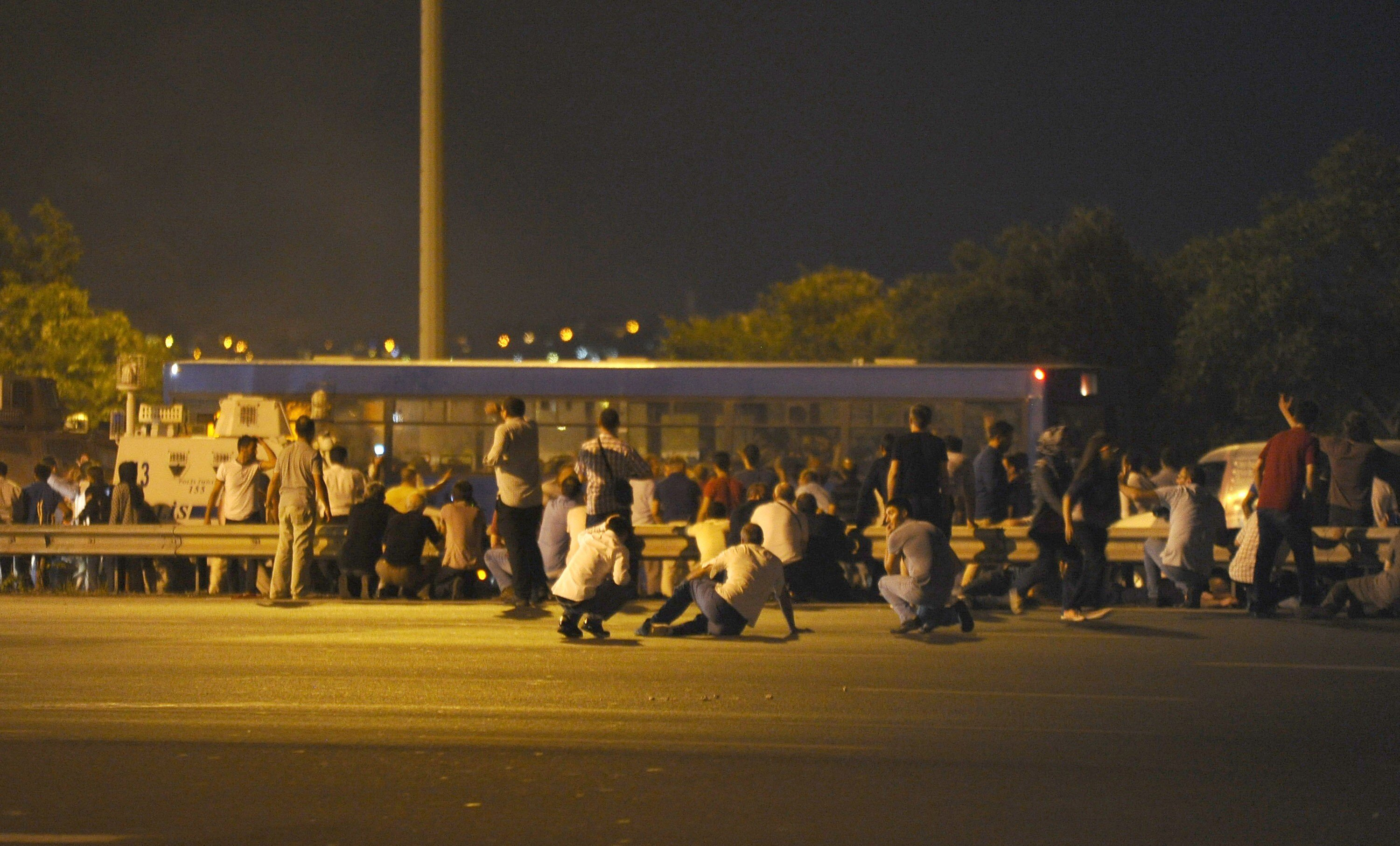 Civilians stopped a bus full of soldiers right before entering the bridge.