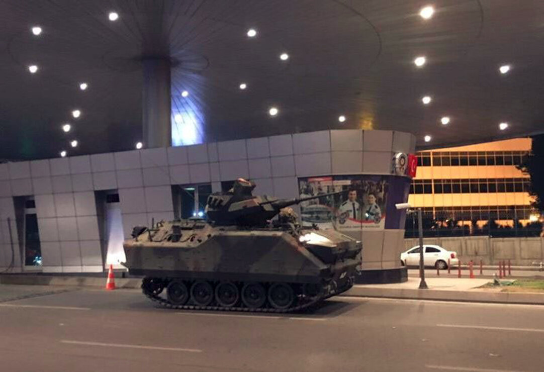 An armored personnel carrier blocked the entrance to the airport.